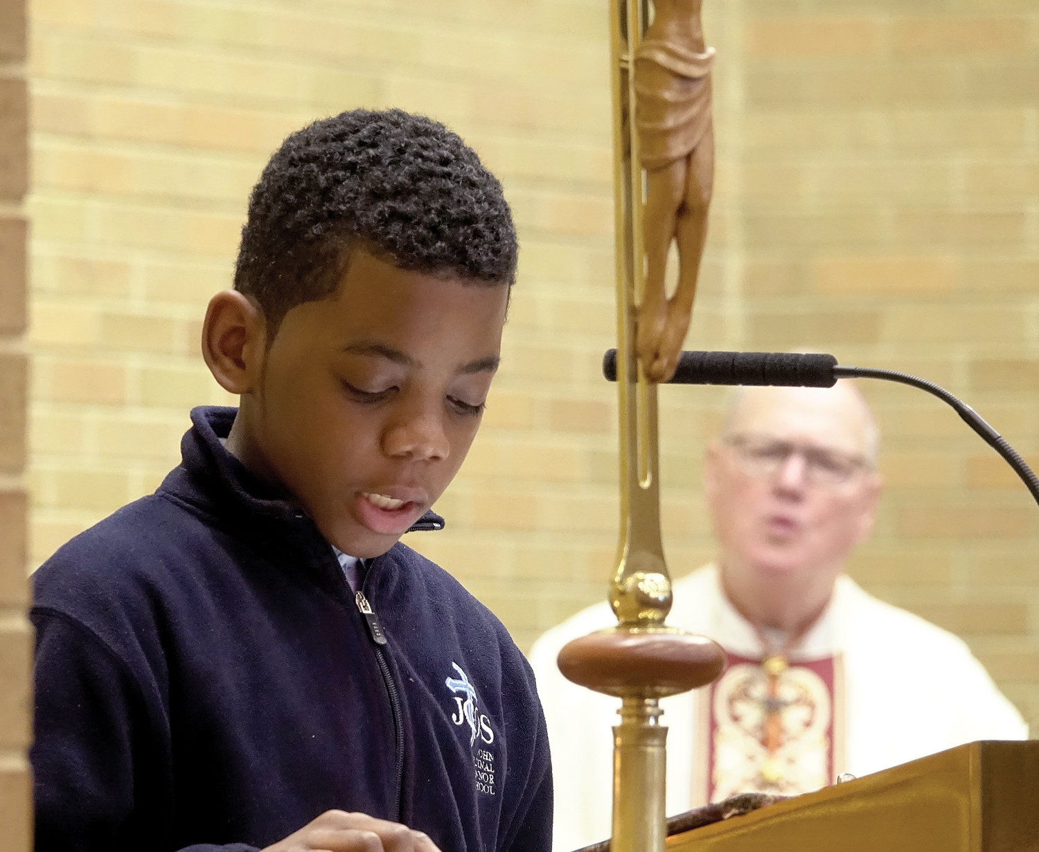 Kennedy Belezaire delivers the Prayer of the Faithful during the morning liturgy.