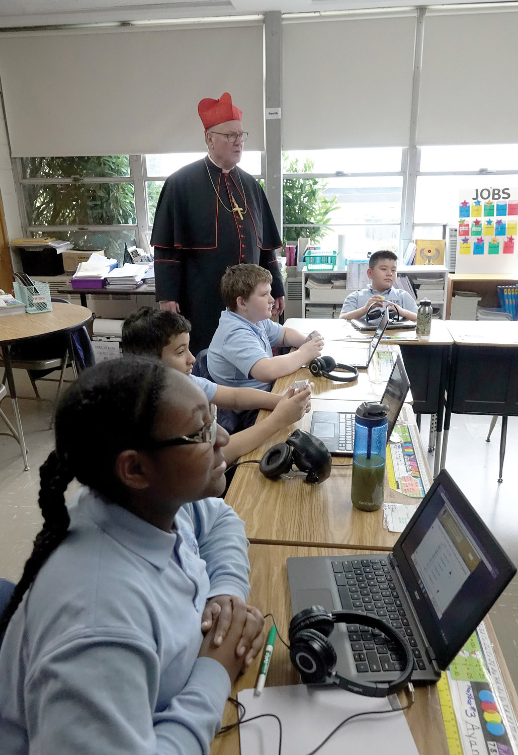 Cardinal Dolan tours the computer class at the John Cardinal O'Connor School in Irvington Jan. 27, the second day of National Catholic Schools Week.