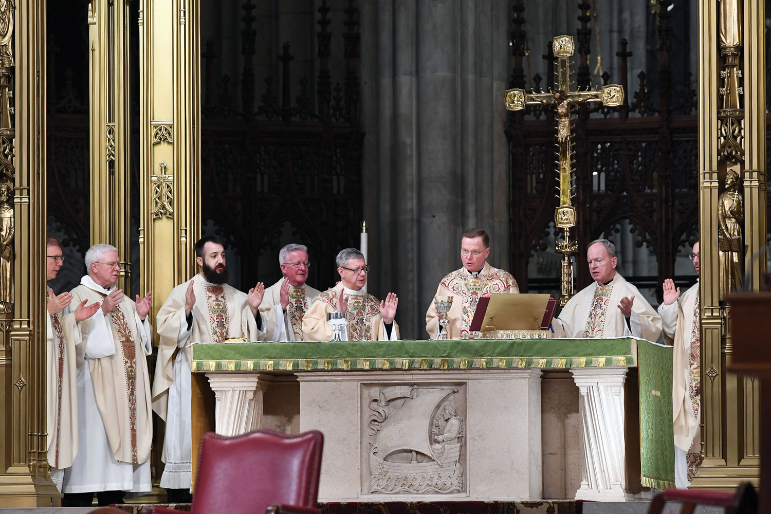 "Auxiliary Bishop Edmund J. Whalen, holding chalice, was the principal celebrant of a Jan. 15 Mass in St. Patrick's Cathedral marking the 100th anniversary of the birth of Cardinal John O'Connor. The bishop was joined at the altar by concelebrants including Auxiliary Bishop Gerardo J. Colacicco, near left. Bishop Whalen remembered the cardinal, who died in May 2000, as ""a wonderful priest and a fearless leader."""
