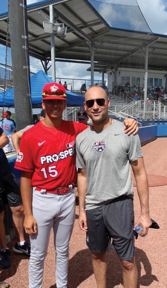 Jeter meets Mount St. Michael Academy student Alex Santos at the Prospect Development Pipeline League at the IMG Academy in Bradenton, Fla., last summer.