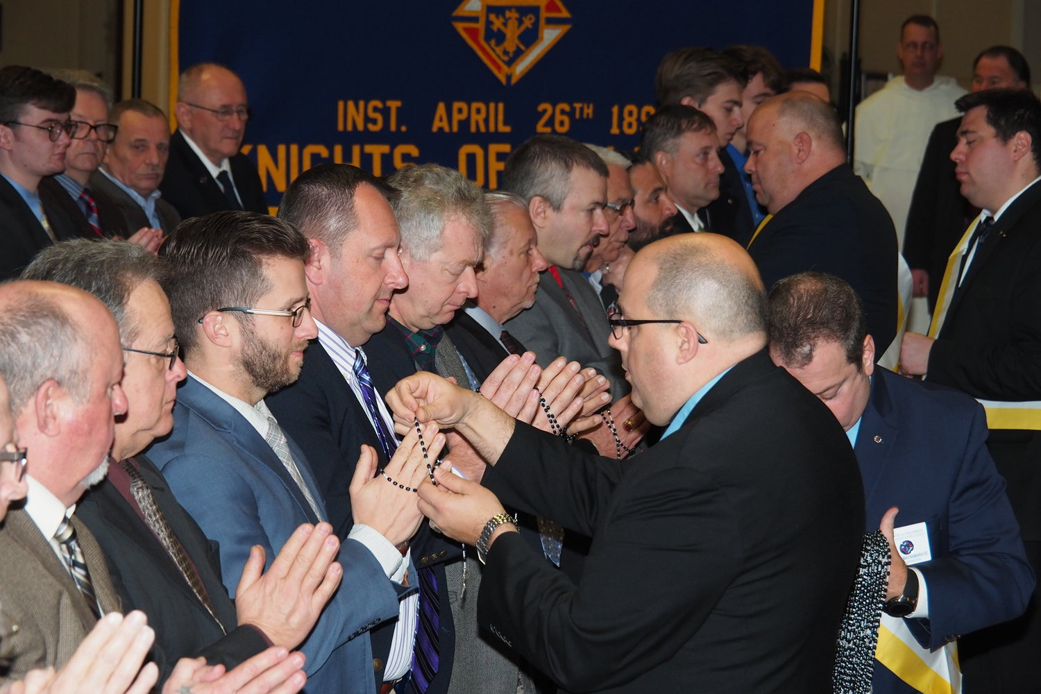 Members of the Knights of Columbus receive rosaries Jan. 1 as part of the organization's new ceremony that is designed to condense the initiation of the Knights' first three degrees into one. In addition, the ceremony is now conducted in public instead of in a secret, members-only occasion.