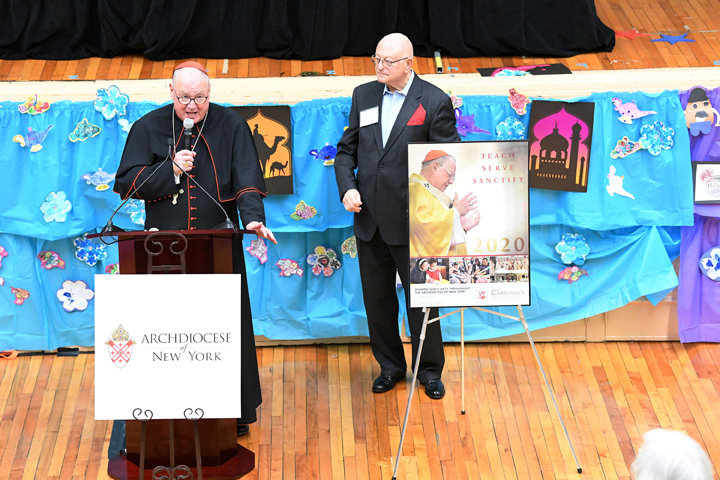 Cardinal Dolan addressed attendees at the reception as Joe Messineo of the CASA Leadership Committee looked on.