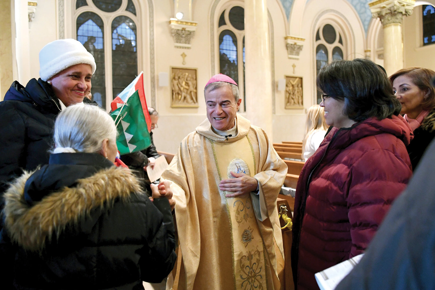 Archbishop Gonzalez warmly greets those who attended the Mass.