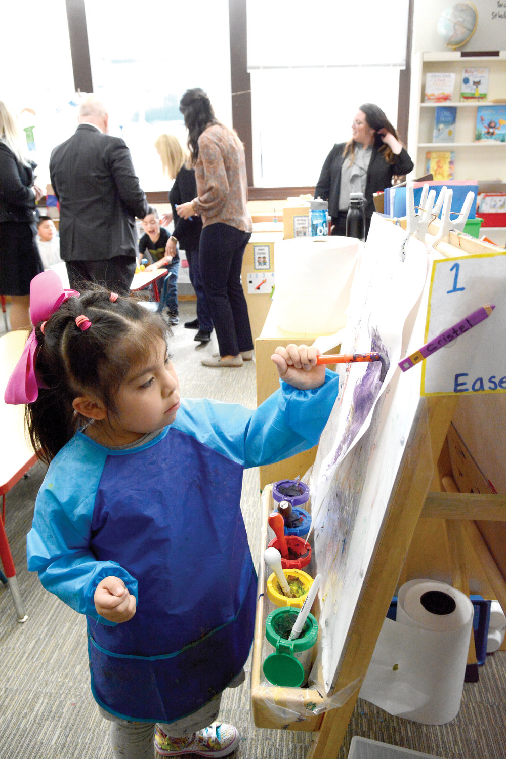 ARTIST AT WORK—Cristel Cuadros, who is enrolled in the new universal pre-k program at Corpus Christi-Holy Rosary School in Port Chester, enjoys painting during class Jan. 31, the same day Cardinal Dolan visited and blessed the remodeled Central Avenue building that houses the program.