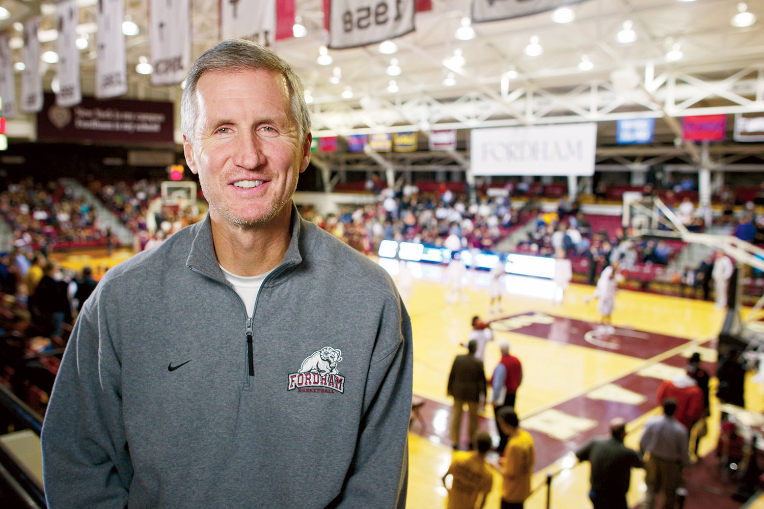 CALL TO HALL—Mike Breen, a 2020 winner of the Curt Gowdy Media Award for the Naismith Memorial Basketball Hall of Fame in Springfield, Mass., smiles at Rose Hill Gymnasium during a visit to his alma mater, Fordham University.
