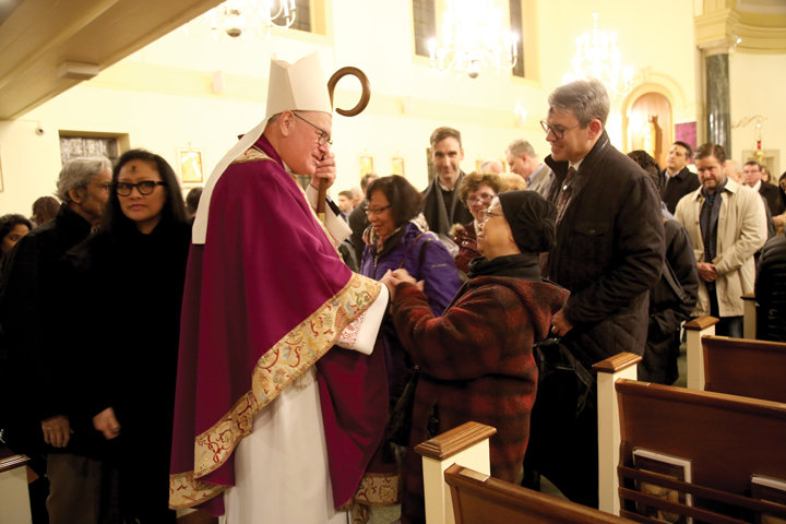 LENT BEGINS—Cardinal Dolan greets the faithful at Our Lady of Victory Church in Lower Manhattan after celebrating Mass there on Ash Wednesday, Feb. 26. Father Myles Murphy is the pastor of Our Lady of Victory and St. Andrew parish.