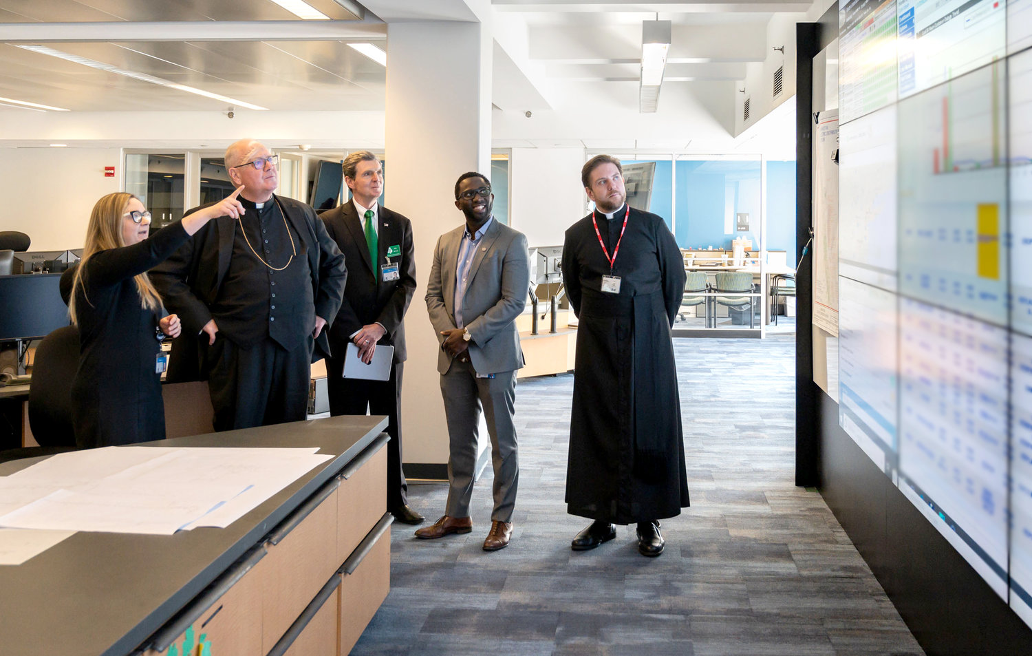 Cardinal Dolan joined Con Edison's Emerald Society for a celebration of Irish-American history March 5. The cardinal spoke to more than 200 employees at Con Ed's headquarters in Union Square about one of his predecessors, Archbishop John Hughes, who led the Catholic Church in New York during a period of tremendous growth in the 19th century. The cardinal is shown in the electric operations control room with, from left, Michelle DeMascio, control room manager; John McAvoy, chairman and CEO of Con Edison; Shaun Smith, general manager; and Father Stephen Ries, the cardinal's priest secretary.