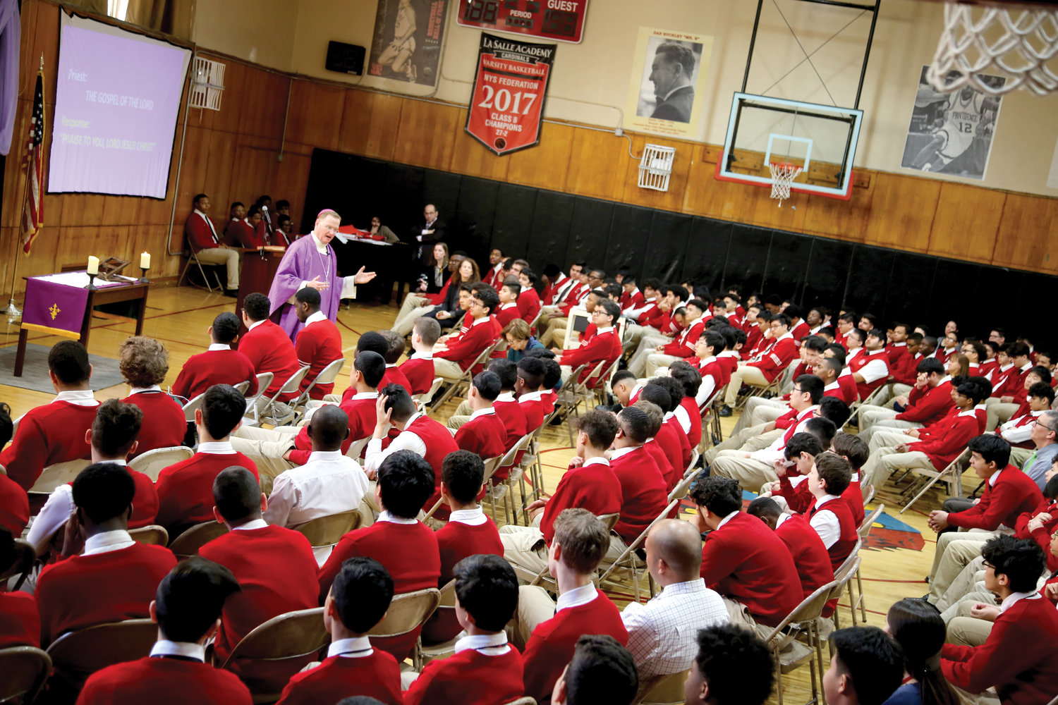Auxiliary Bishop Edmund Whalen, vicar for clergy in the archdiocese, offers Mass March 2 at La Salle Academy, a boys' high school in lower Manhattan.
