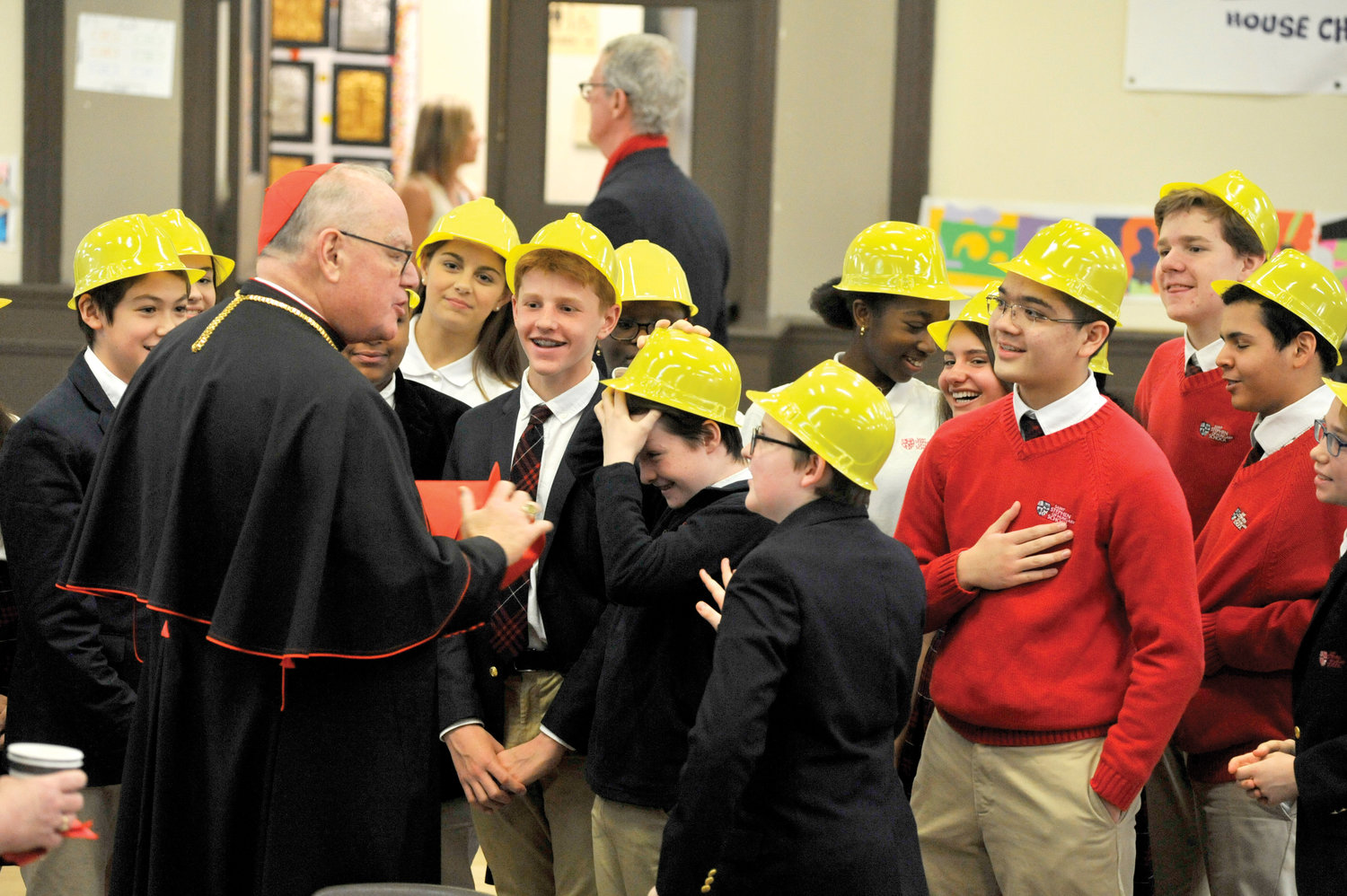 Cardinal Dolan shares a festive moment with students at St. Stephen of Hungary School in Manhattan March 11.
