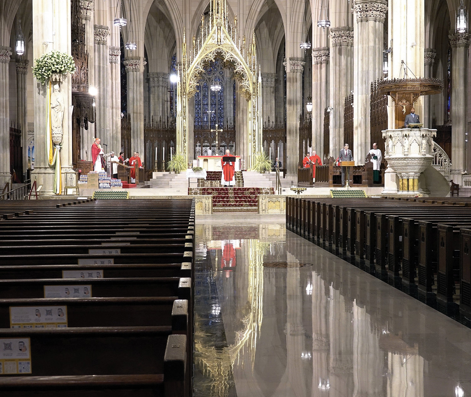 The pews of St. Patrick's Cathedral are empty of parishioners. Current standards for public gatherings due to the coronavirus crisis do not permit Mass to be offered publicly in the archdiocese. The Easter Sunday Mass from St. Patrick's Cathedral will also be televised on PIX11 at 10 a.m. on April 12.