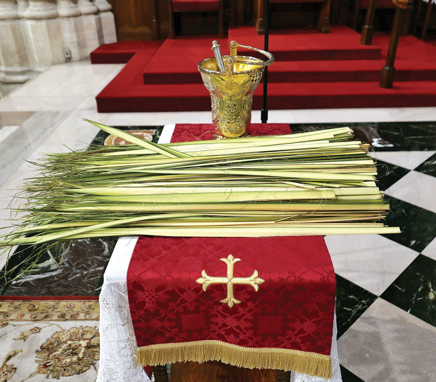 Strips of palm sit on a table where Cardinal Dolan blessed them at the start of Mass.