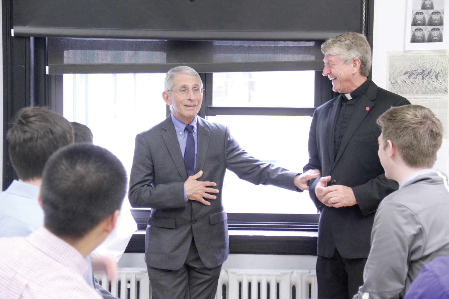 DISTINGUISHED ALUMNUS—Dr. Anthony Fauci meets with Regis High School students and the school's president, Jesuit Father Daniel Lahart, in 2019.