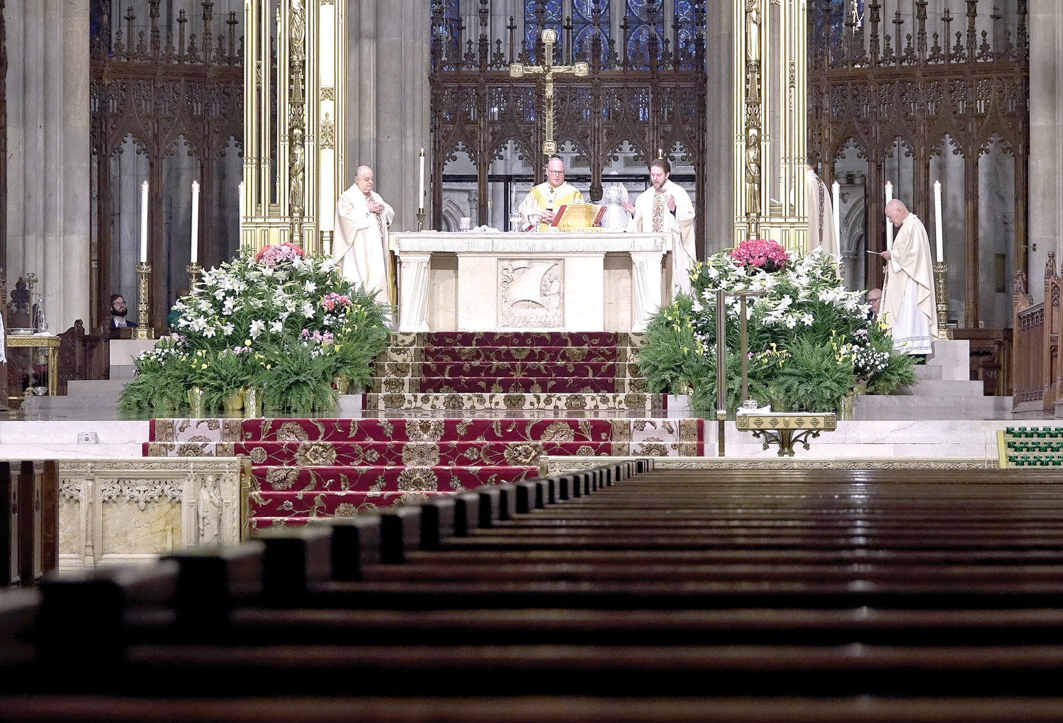 ALLELUIA—During the 10 a.m. Mass celebrated by Cardinal Dolan on Easter Sunday, April 12, the resplendent cathedral had rows of empty pews. The large congregation that customarily attends was not permitted as Masses are being offered without people physically present as a precaution due to the coronavirus pandemic.