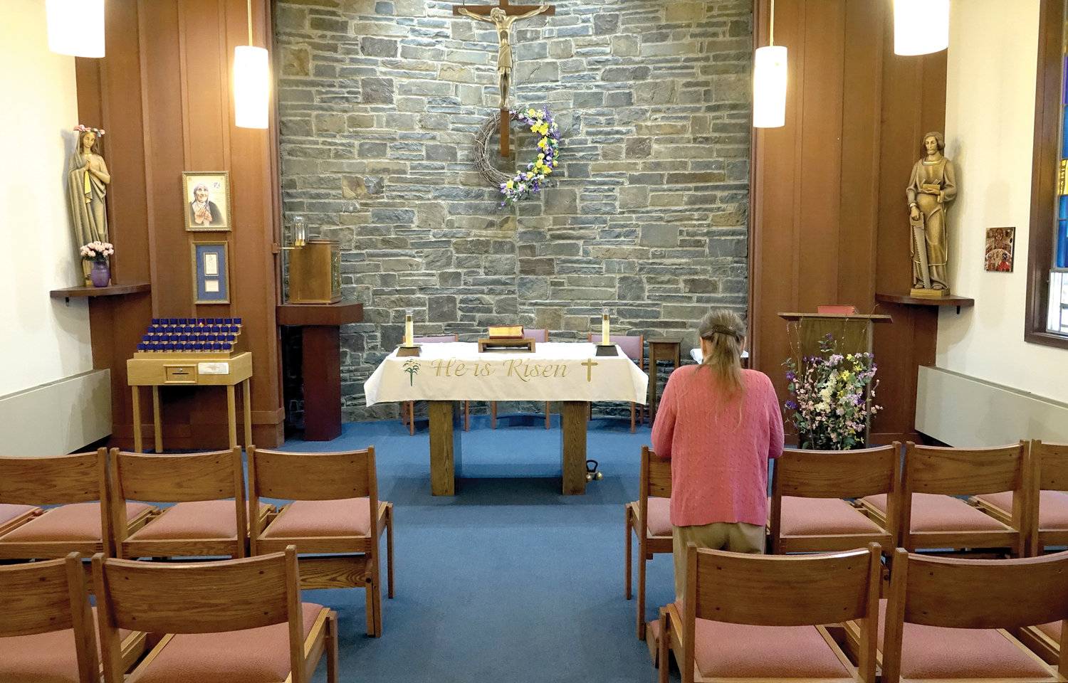 AT PRAYER—A woman prays in the chapel of St. Mary of the Snow in Saugerties May 2.