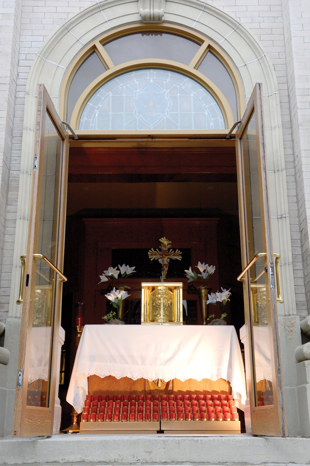 HOPE AND HEALTH—The Blessed Sacrament, in the tabernacle near the front doors of St. Barnabas Church, the Bronx, offers respite for parishioners who pass by.