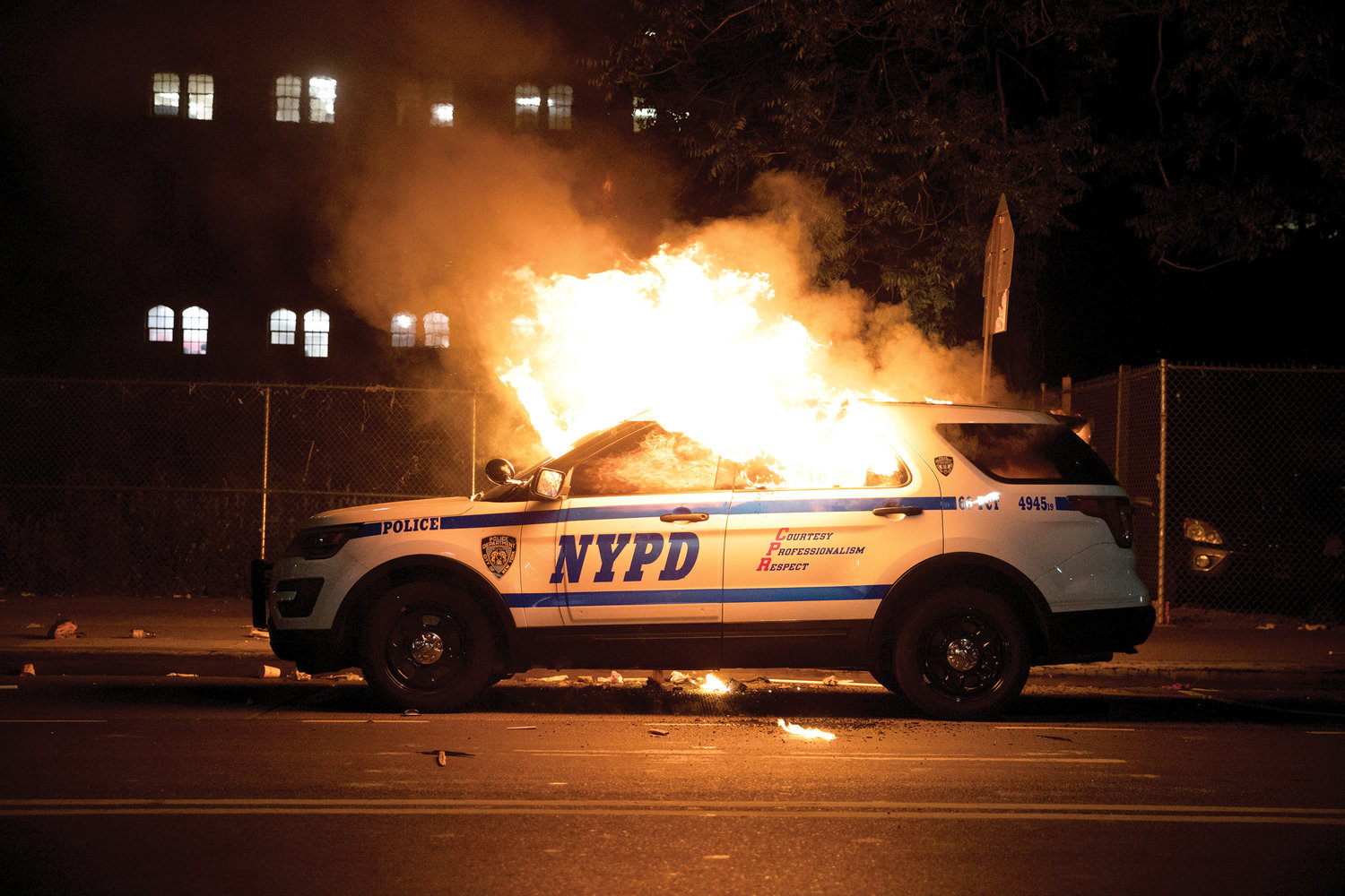 A New York City police car, above, is set on fire May 30.