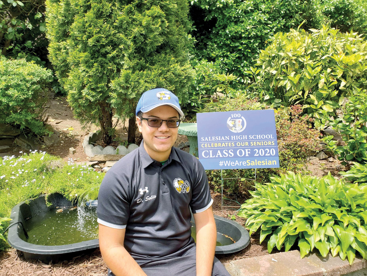 PROUD SENIOR—Salesian High School senior Daniel Solis sits in a photo with 