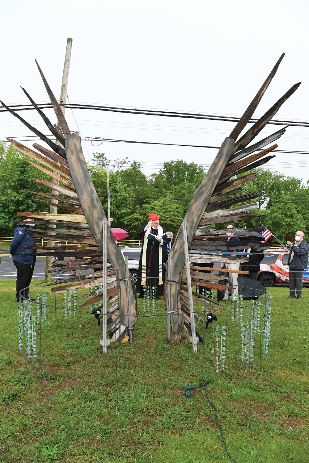 Cardinal Dolan blesses the 942 Voices sculpture at Mount Loretto on Staten Island May 23. The sculpture honors Staten Islanders who have lost their lives during the coronavirus pandemic, including two residents of Mount Loretto residential care facility.