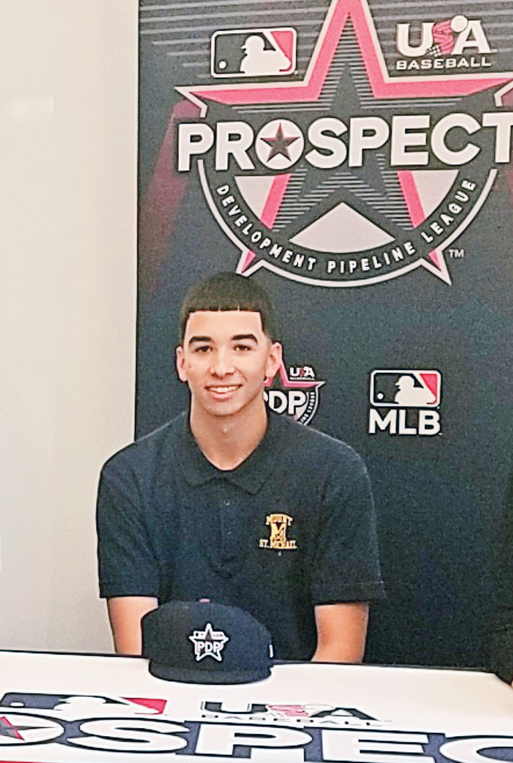 OFF TO PROS—Mount St. Michael Academy graduate Alex Santos was selected by the Houston Astros with their first pick in the 2020 Major League Baseball Draft June 11. In this photo, Santos celebrates his selection to the inaugural Prospect Development Pipeline League with family, friends and coaches at Mount St. Michael in 2019.