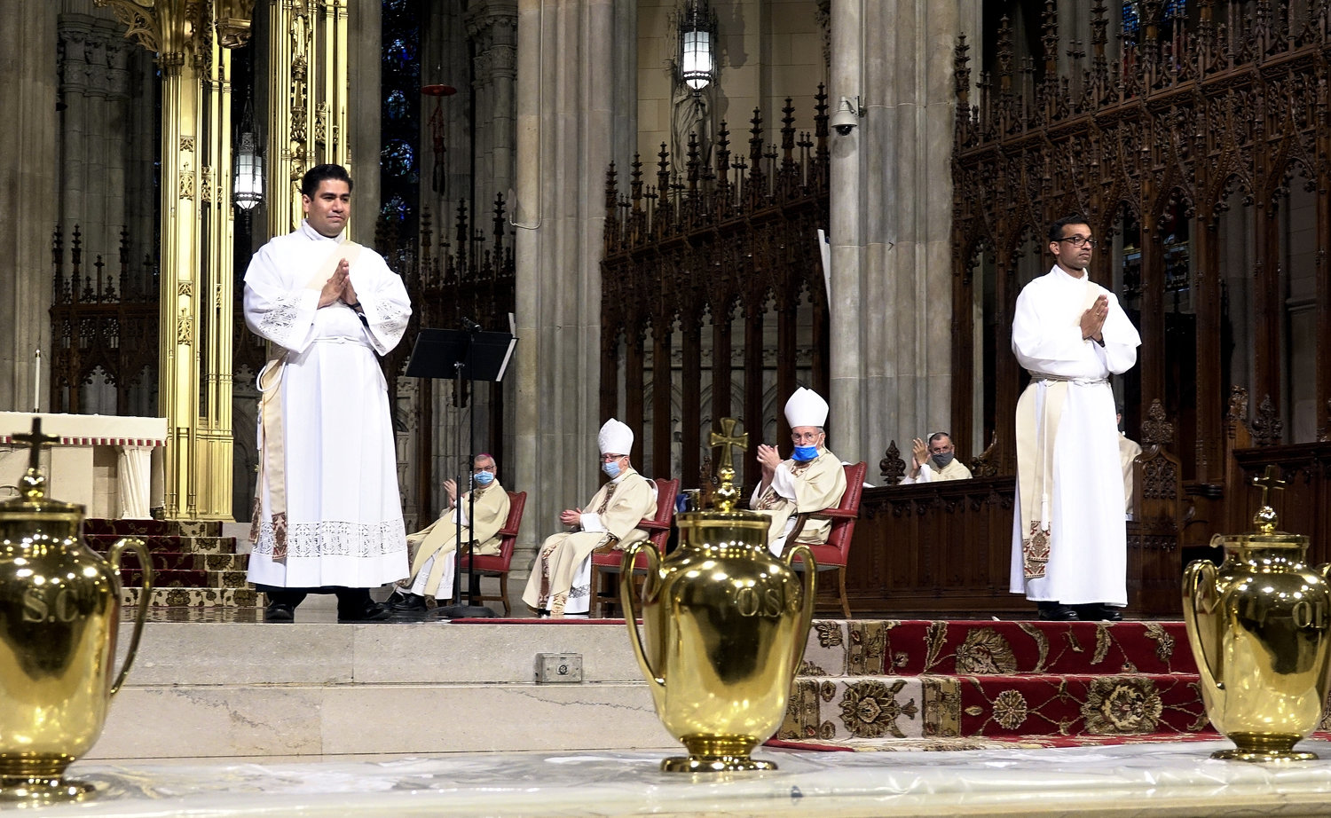 The two newly ordained priests, Father Luis Silva and Father Roland Pereira, M.Id., receive the applause of the congregation at St. Patrick's Cathedral.