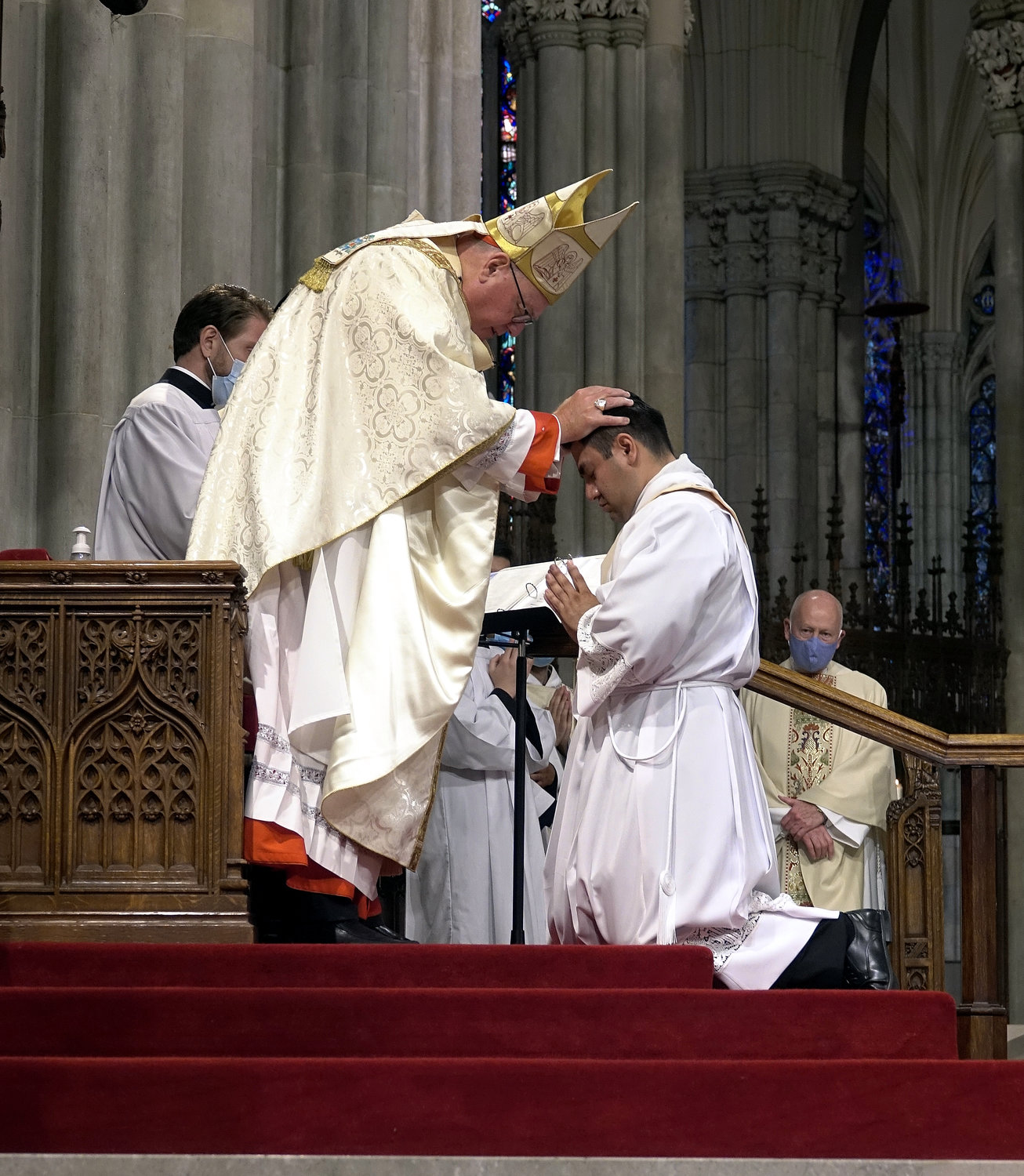 Cardinal Dolan lays hands on Father Luis Silva during the Rite of Ordination.