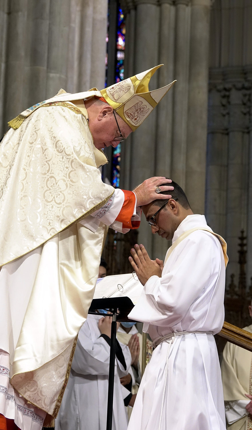 Cardinal Dolan lays hands on Father Roland Pereira, M.Id., during the Rite of Ordination.