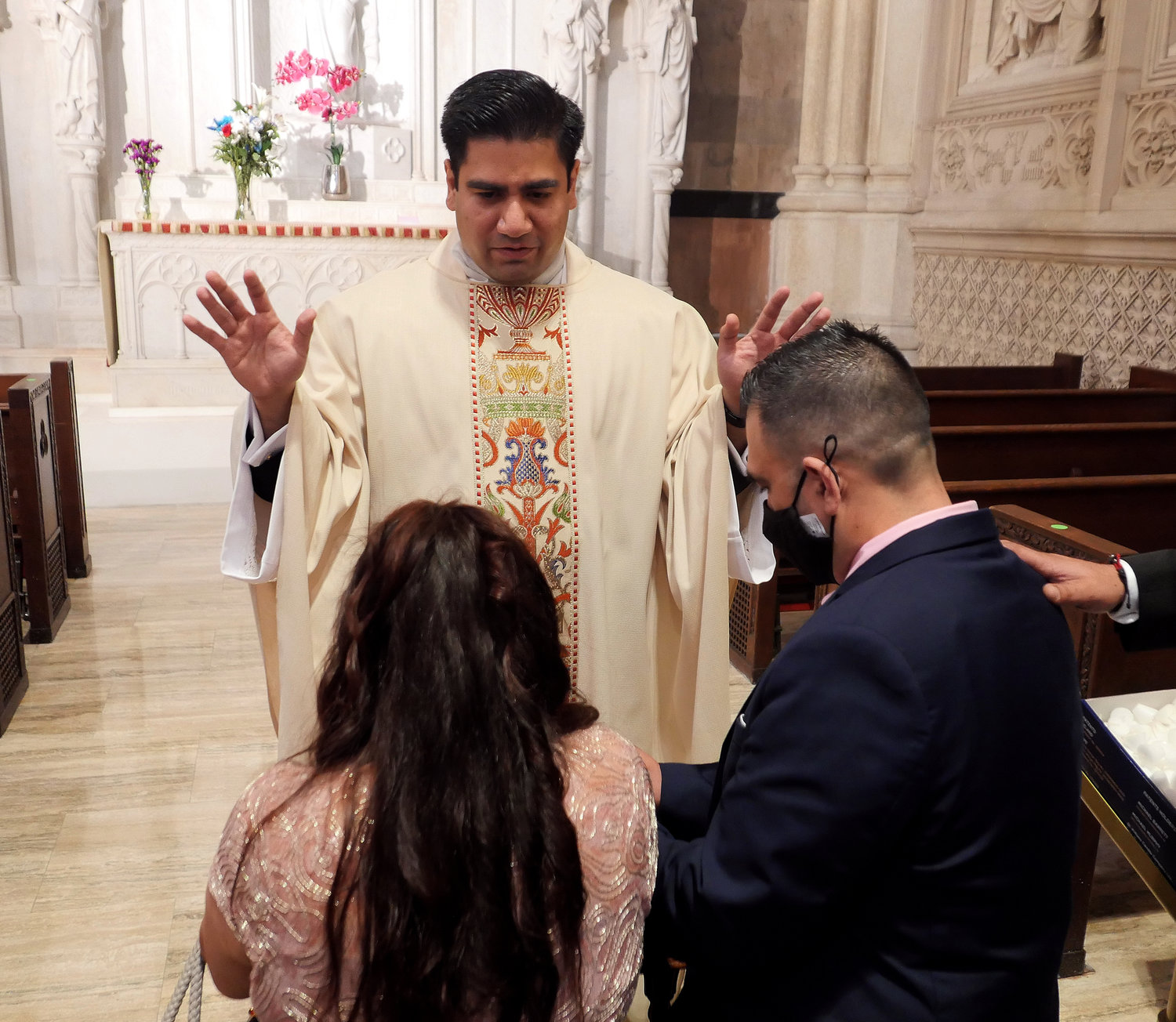 Father Luis Silva offers a first blessing after the Mass of Ordination.