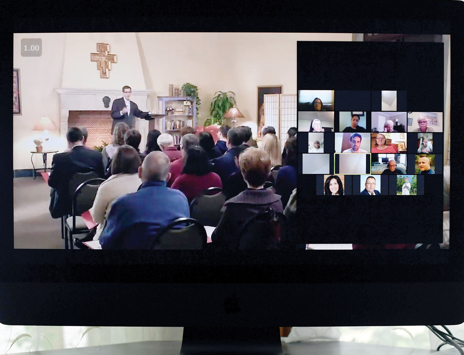 "ChristLife participants watch a video, ""Called to Share Christ,"" hosted by Dave Nodar, director and founder of ChristLife, at the start of a meeting hosted by the archdiocesan Office of Adult Faith Formation July 7."