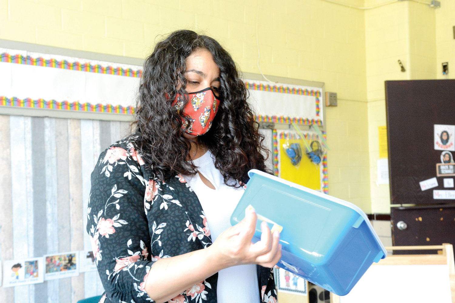 Johanna Ellerbe, pre-k director, explained changes in the setup of a pre-k classroom during a July 22 tour of the retrofitted Immaculate Conception School on East Gun Hill Road, the Bronx.