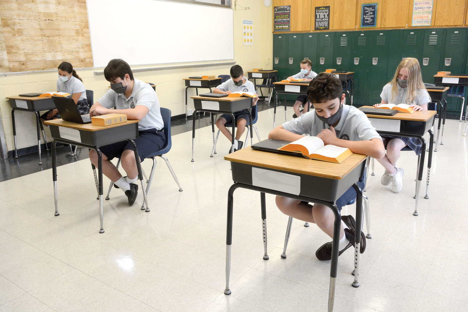 Some sixth-, seventh- and eighth-graders of St. Joseph School in Bronxville demonstrate Aug. 7 what a typical day inside a classroom will look like, with coronavirus protocols