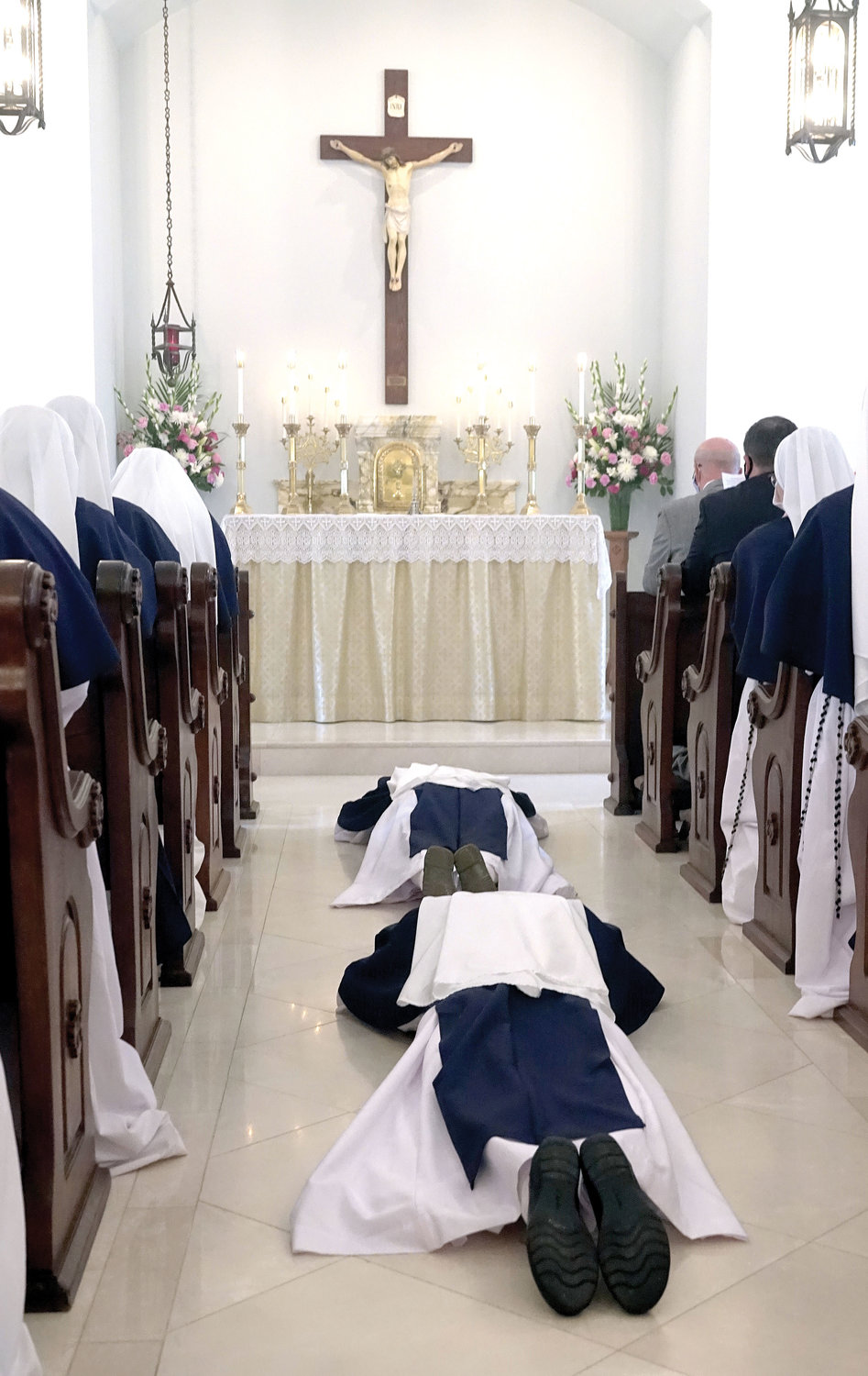 Sister Virginia Joy, S.V. and Sister Naomi Maria Magnificat, S.V., lay prostrate on the chapel floor.