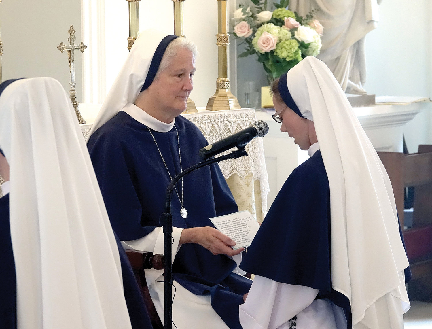 Sister Naomi Maria Magnificat, S.V., professes vows before Mother Agnes Mary Donovan, S.V., superior general of the Sisters of Life.