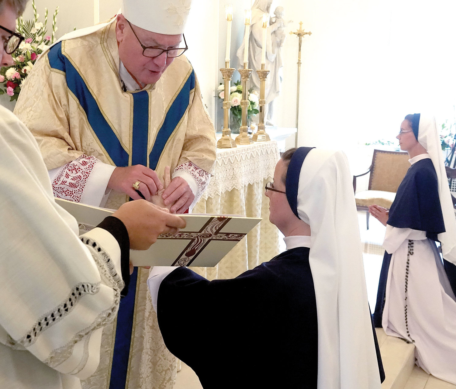 Sister Virginia Joy, S.V., receives her ring from Cardinal Dolan, who served as principal celebrant of the Mass of Perpetual Profession.