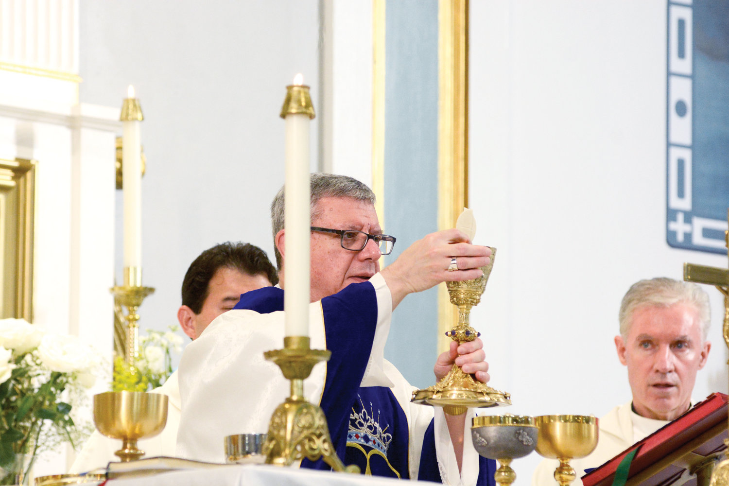 TABLE OF THE LORD—Auxiliary Bishop Gerardo J. Colacicco prays during the consecration of the Eucharist at the Vigil Mass for the Feast of the Assumption of the Blessed Virgin Mary Aug.14 at Assumption Church in Peekskill.