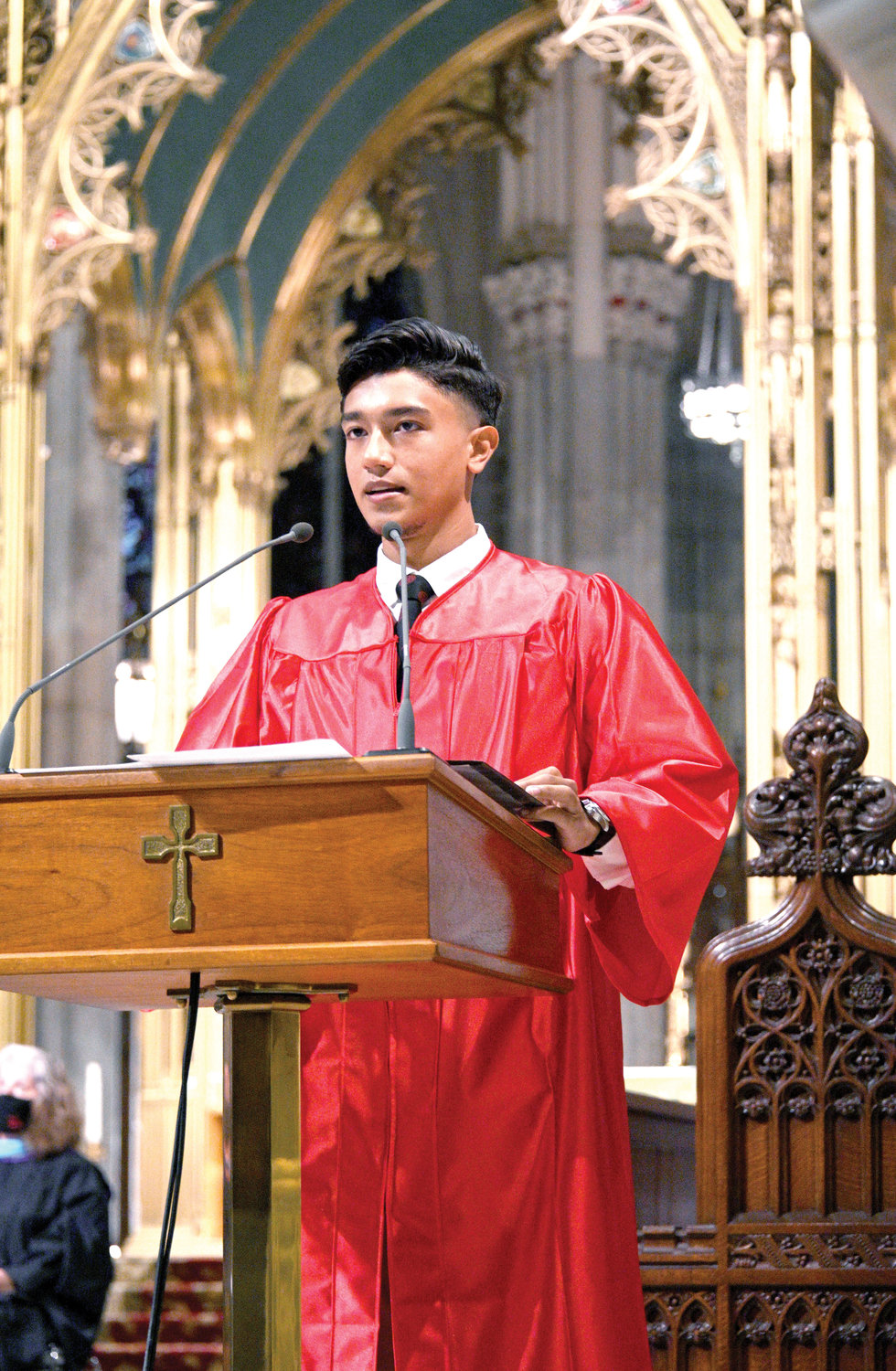 Co-valedictorian Steven Dumeng of La Salle Academy's Class of 2020 addresses fellow graduates observing social distancing in their pews during the school's 171st commencement exercises Aug. 13 at St. Patrick's Cathedral.