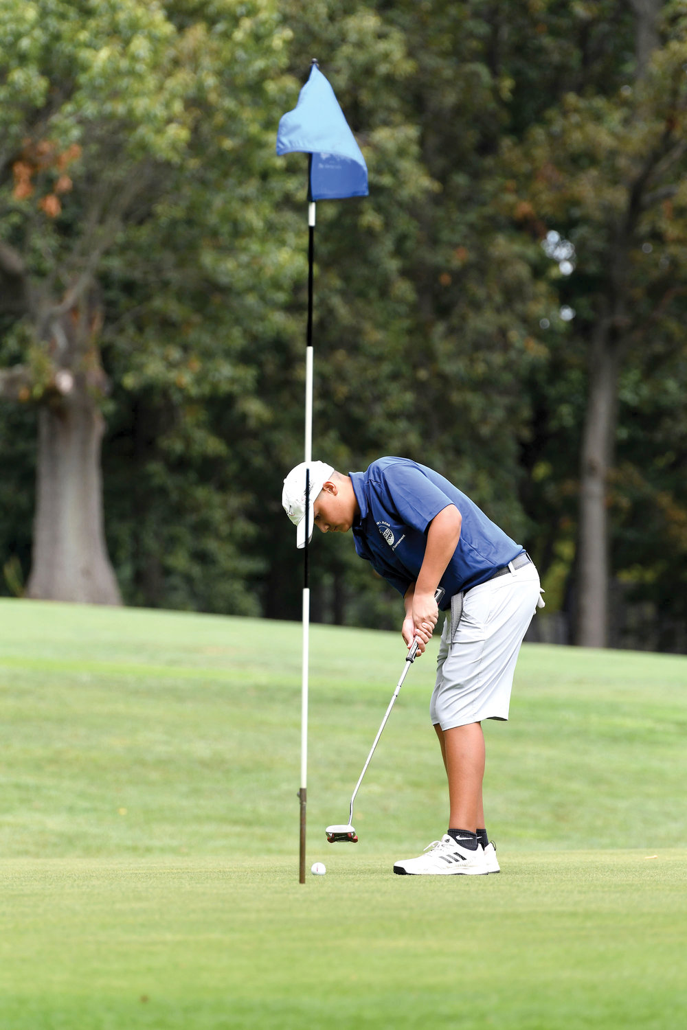 Michael Hui watches the ball head toward the eighth hole during the Dr. Theodore A. Atlas CYO Junior Golf Tournament at Silver Lake Golf Course on Staten Island Sept. 3. Hui and his teammates from Intermediate School 34 won the team championship.