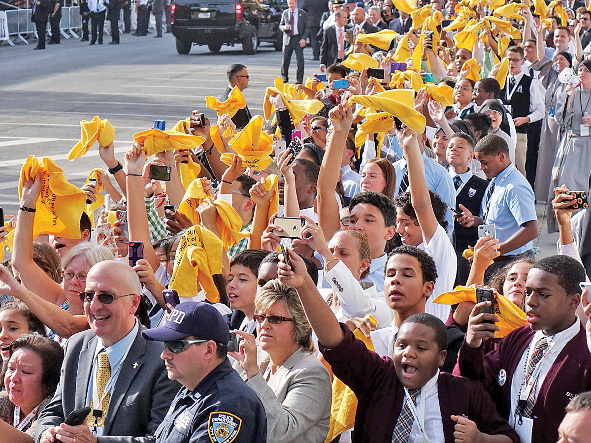 Legions of high school students from around the archdiocese line up outside Our Lady Queen of Angels School in East Harlem, where the pontiff met with students and immigrant New Yorkers.