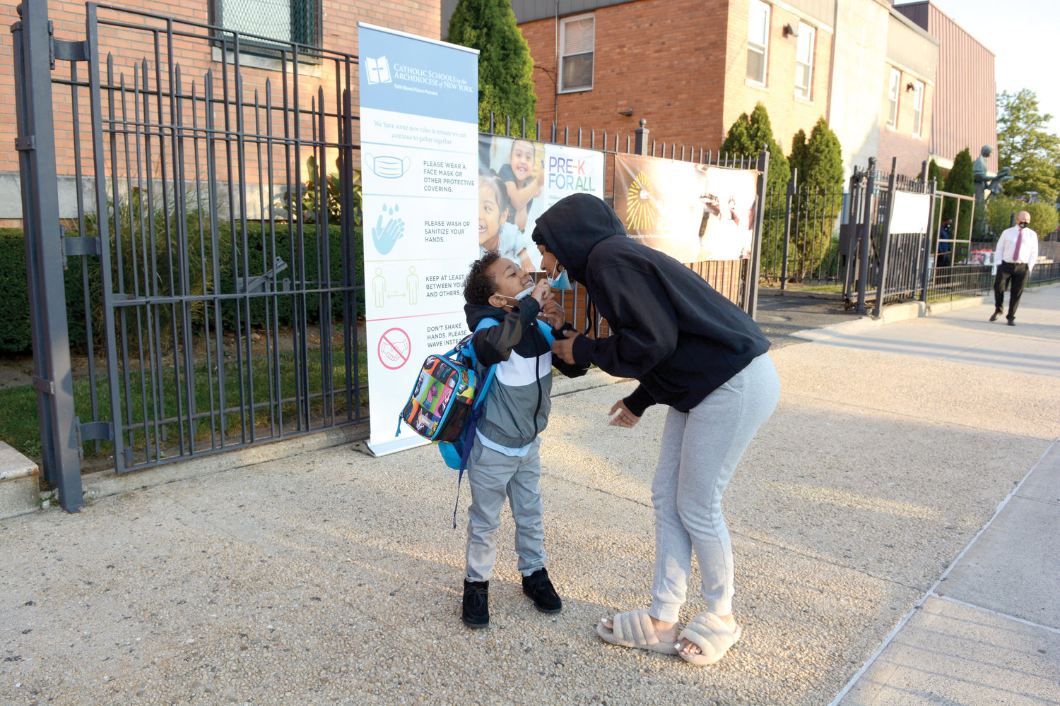 Chelsea Thompson kisses her son, first-grader Chase Torres, before she drops him off at Our Lady of Grace School in the Bronx on the morning of Sept. 22. Our Lady of Grace and other Catholic schools throughout the archdiocese have opened for the 2020-2021 school year.