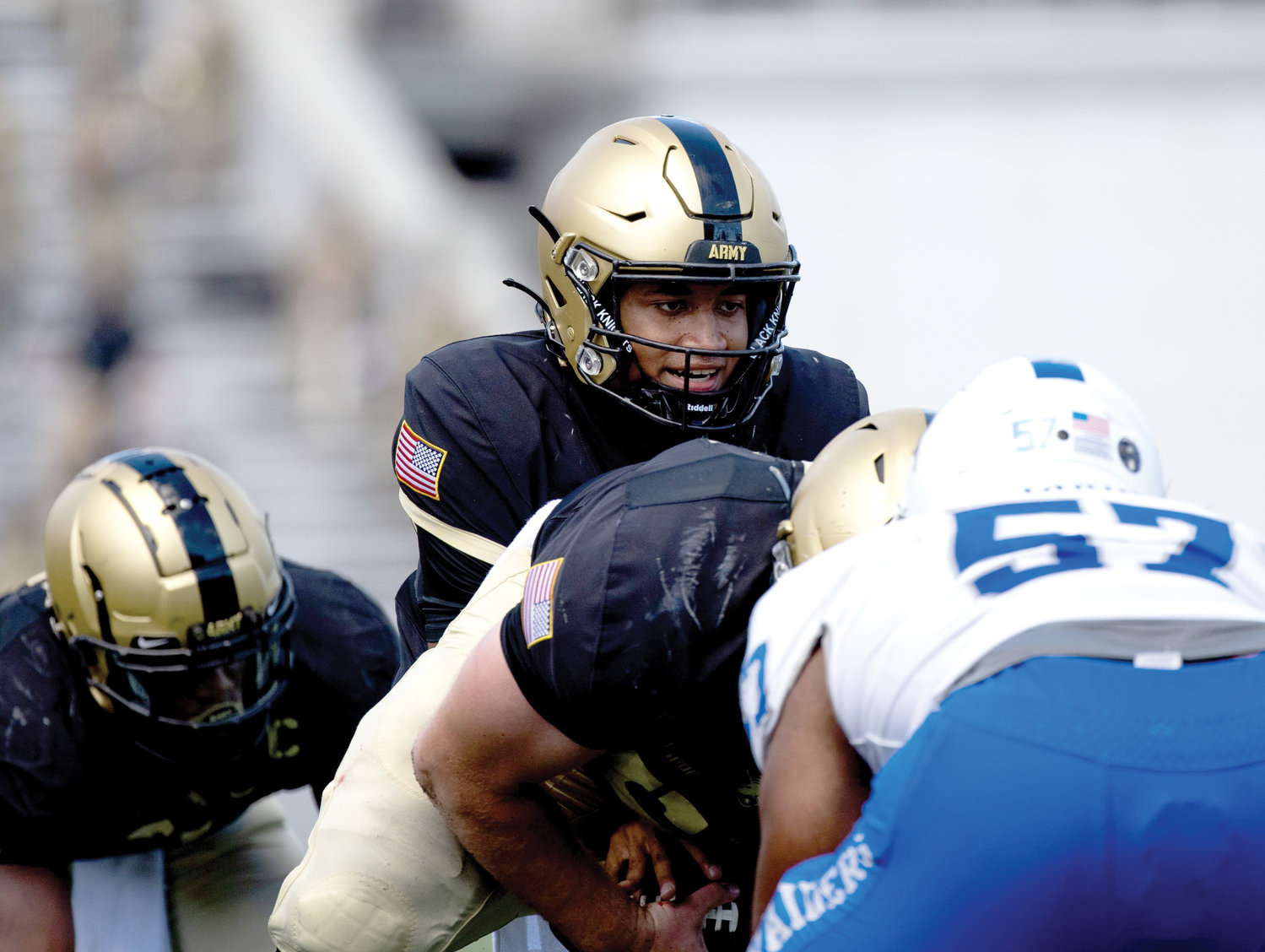 Cardinal Hayes High School graduate Christian Anderson takes a snap from center during Army's 42-0 victory over Middle Tennessee State in West Point Sept. 5. The junior quarterback ran for 51 yards and a touchdown.