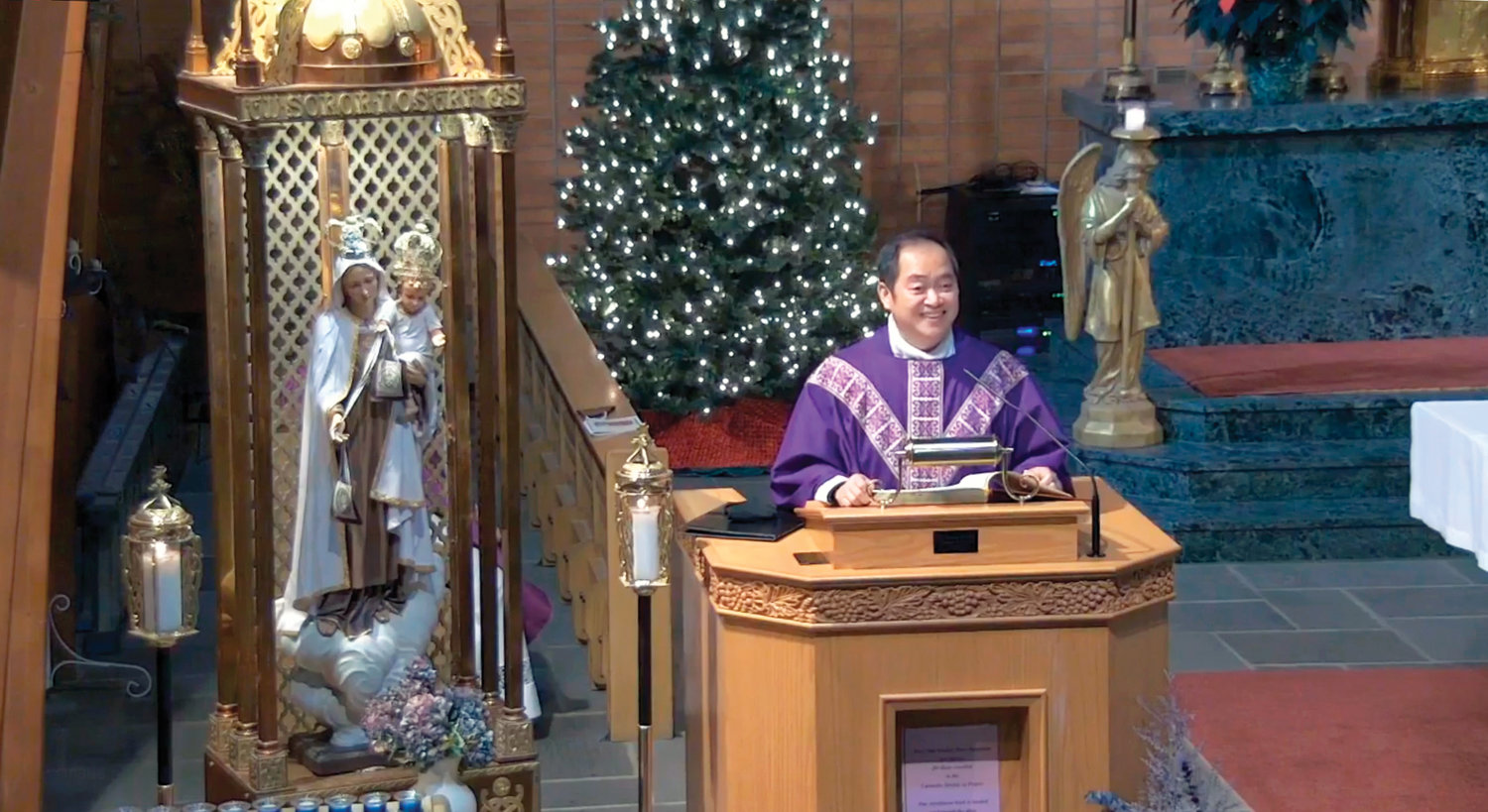 Father Reynor Santiago, parochial vicar of St. Stephen, the First Martyr parish in Warwick and a native of the Philippines, delivers his homily.