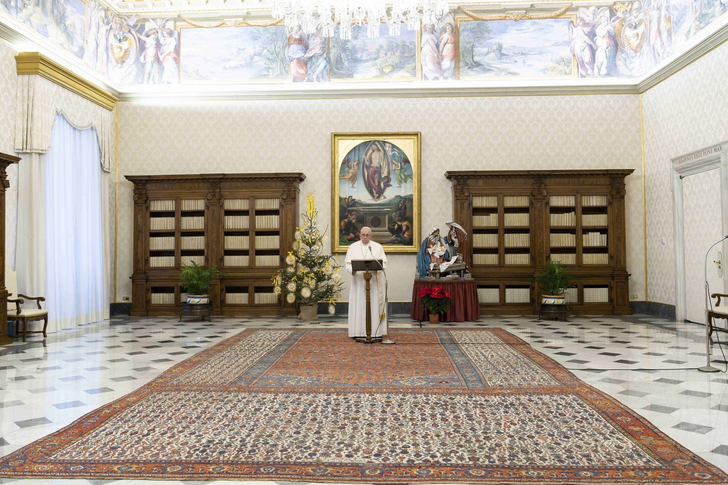 "Pope Francis leads the Angelus prayer from the library of the Apostolic Palace at the Vatican Jan. 3. ""We do not know what 2021 holds for us, but what each one of us, and all of us together, can do is to take care of each other and of creation, our common home,"" he said."