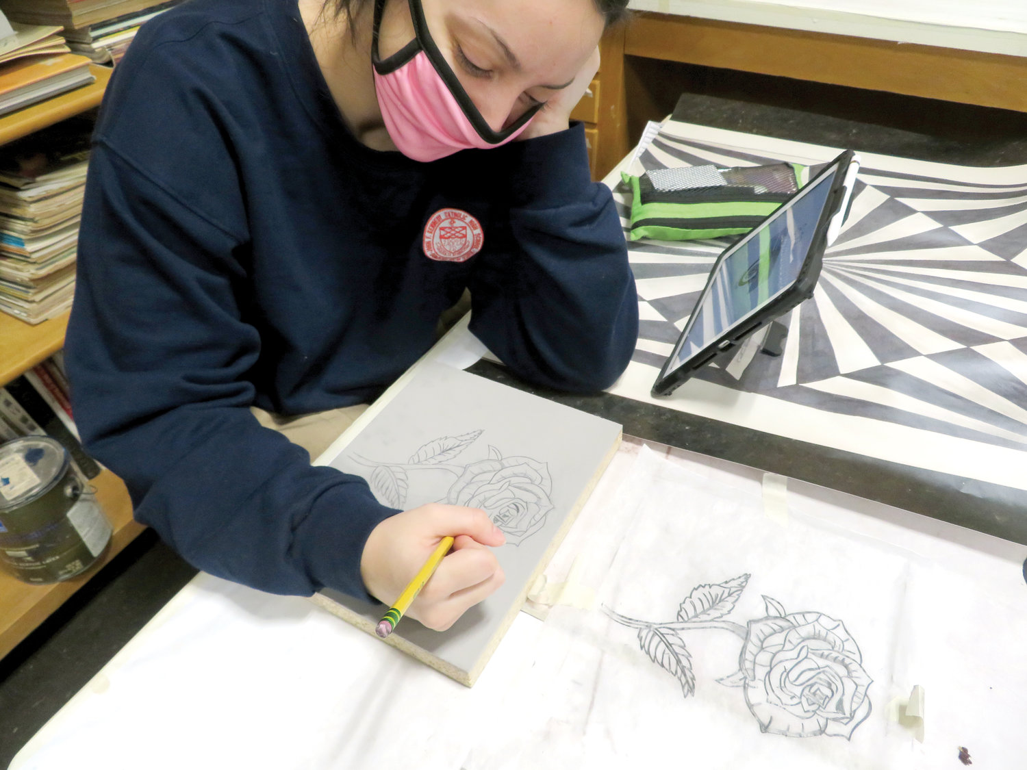 Students at John F. Kennedy Catholic Preparatory School in Somers are divided into two cohort groups that alternate weeks of in-person study with virtual instruction at home. Junior Valeria Acierno works on a drawing in studio art.