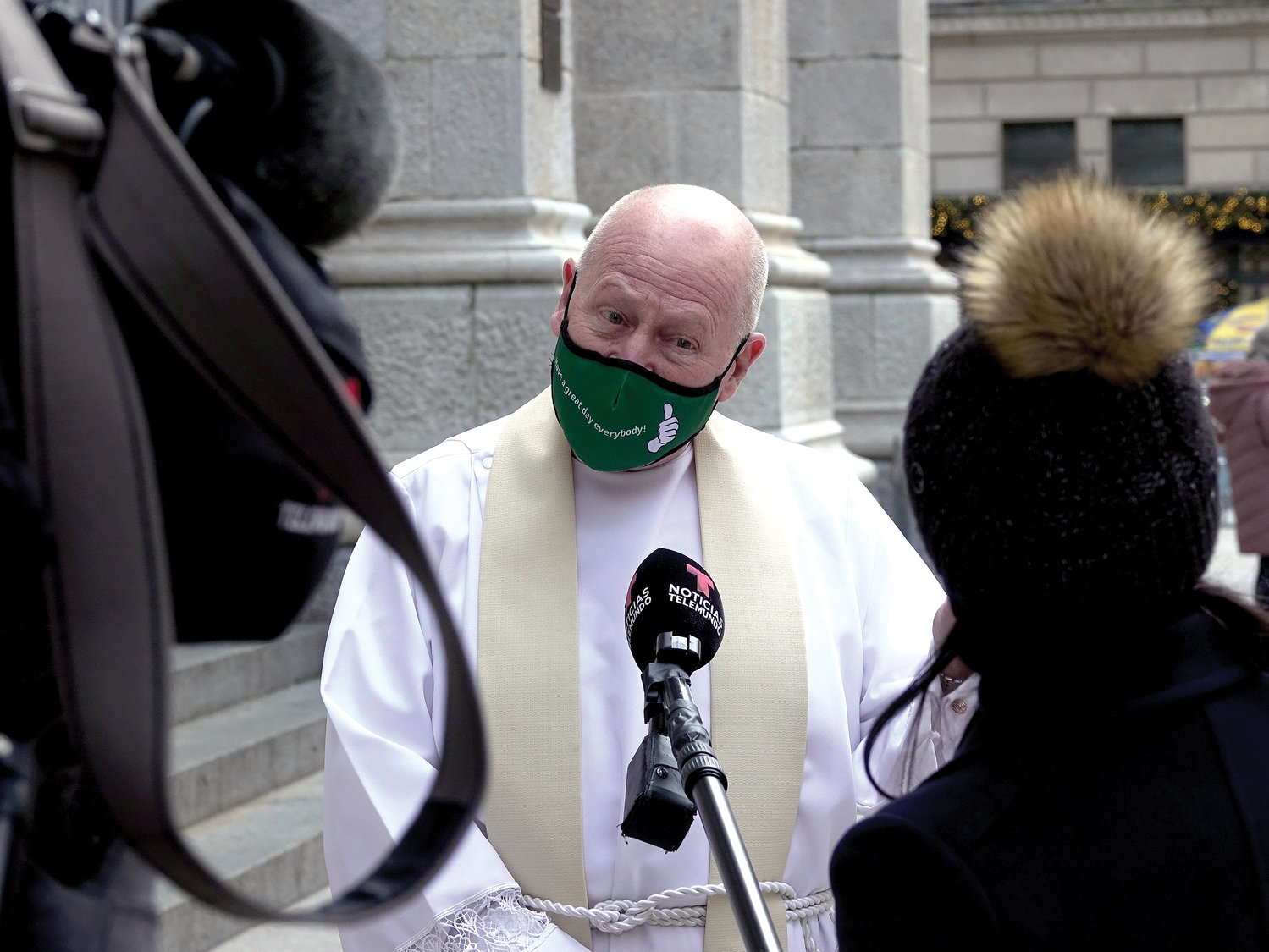 Msgr. Robert Ritchie, rector of St. Patrick's Cathedral, is interviewed on the cathedral steps.