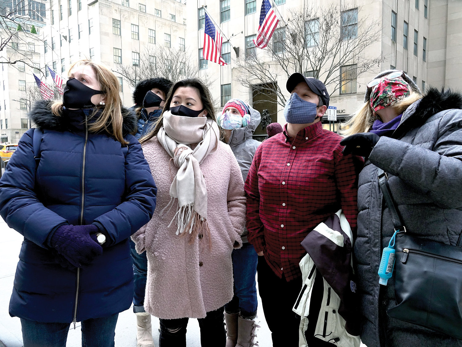 A group gathers to listen to the bells ring at St. Patrick's Cathedral Dec. 30 to remember the victims of the Covid-19 pandemic in the United States.