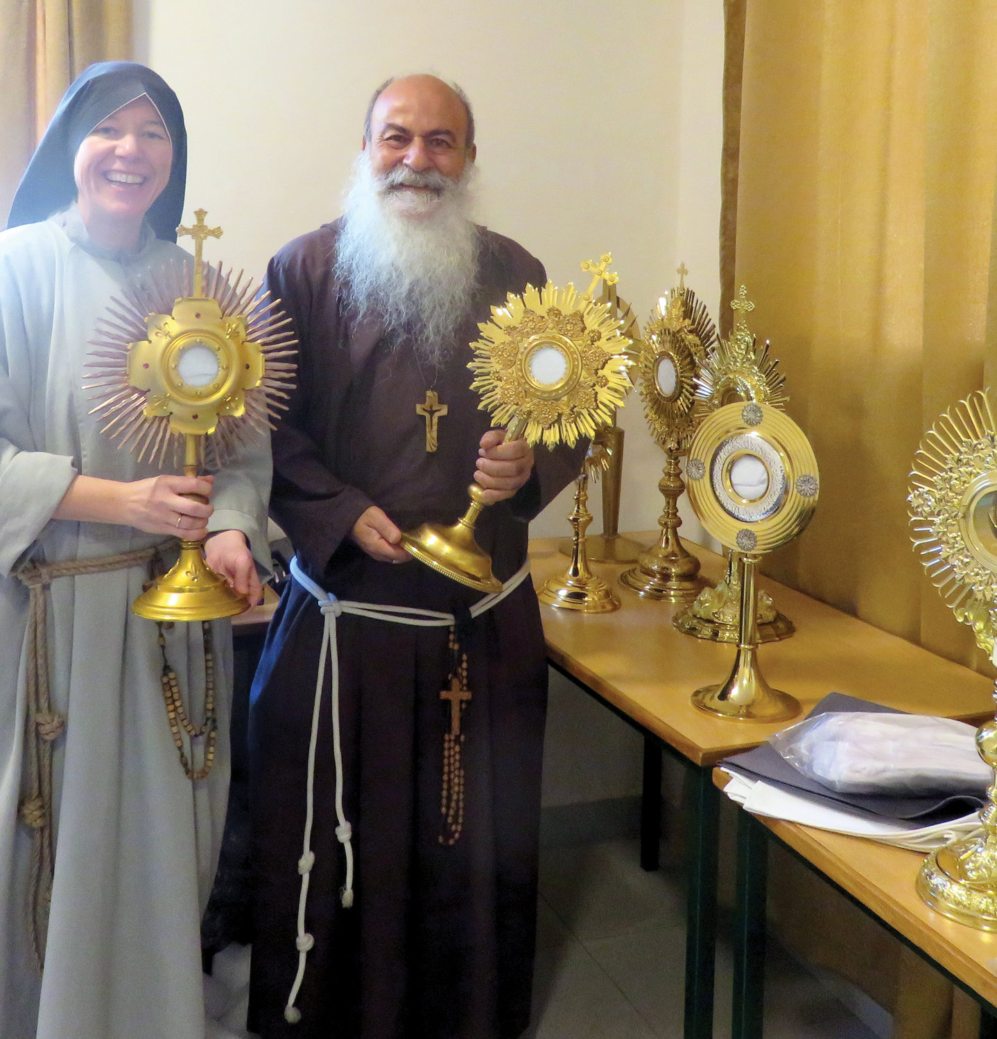 Mother Clare Matthias, C.F.R., community servant (superior general) of the Franciscan Sisters of the Renewal, and Bishop Angelo Pagano, O.F.M. Cap., Vicar Apostolic of Harar, hold monstrances delivered from New York to the Apostolic Vicariate of Harar in Ethiopia.