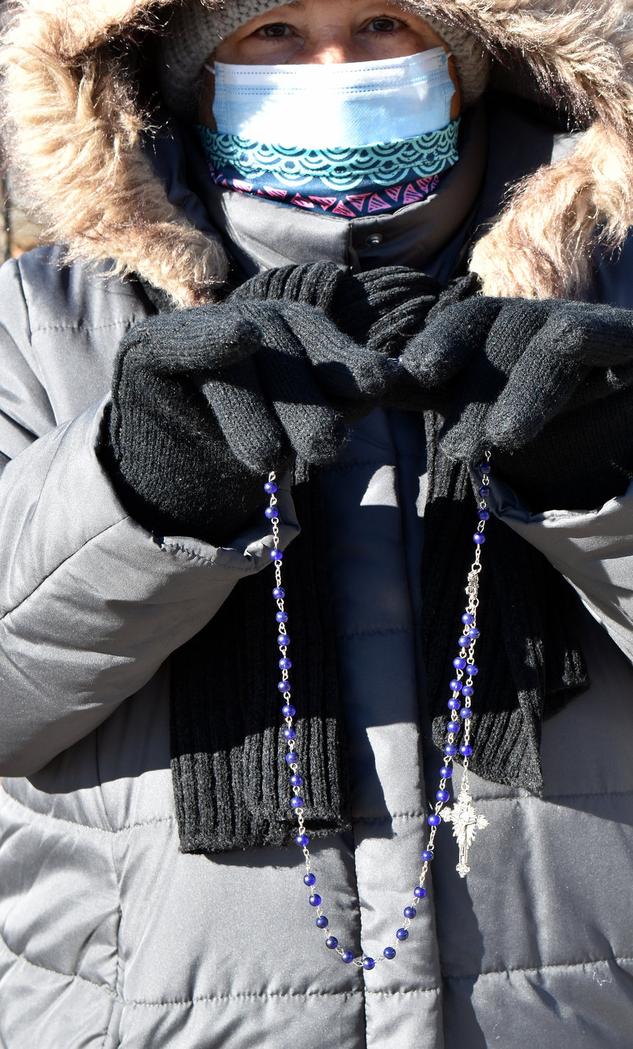 A woman braves frigid conditions Jan. 30 to pray the Rosary for the intention of Respect for Life near an abortion clinic at Eastchester Road in the Bronx.
