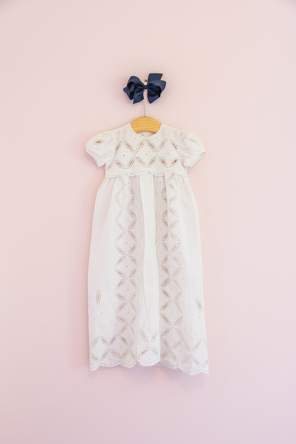 FAMILY TREASURE—The fabric of this christening gown forms a pattern of love knitting together generation after generation of one family.