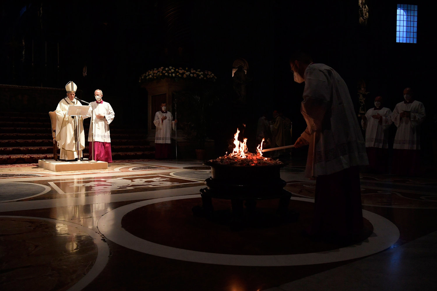 Pope Francis celebrates the Easter Vigil in St. Peter's Basilica at the Vatican April 3. The Easter Vigil was celebrated in a near empty basilica for the second year in a row as Italy continues to fight the Covid-19 pandemic.