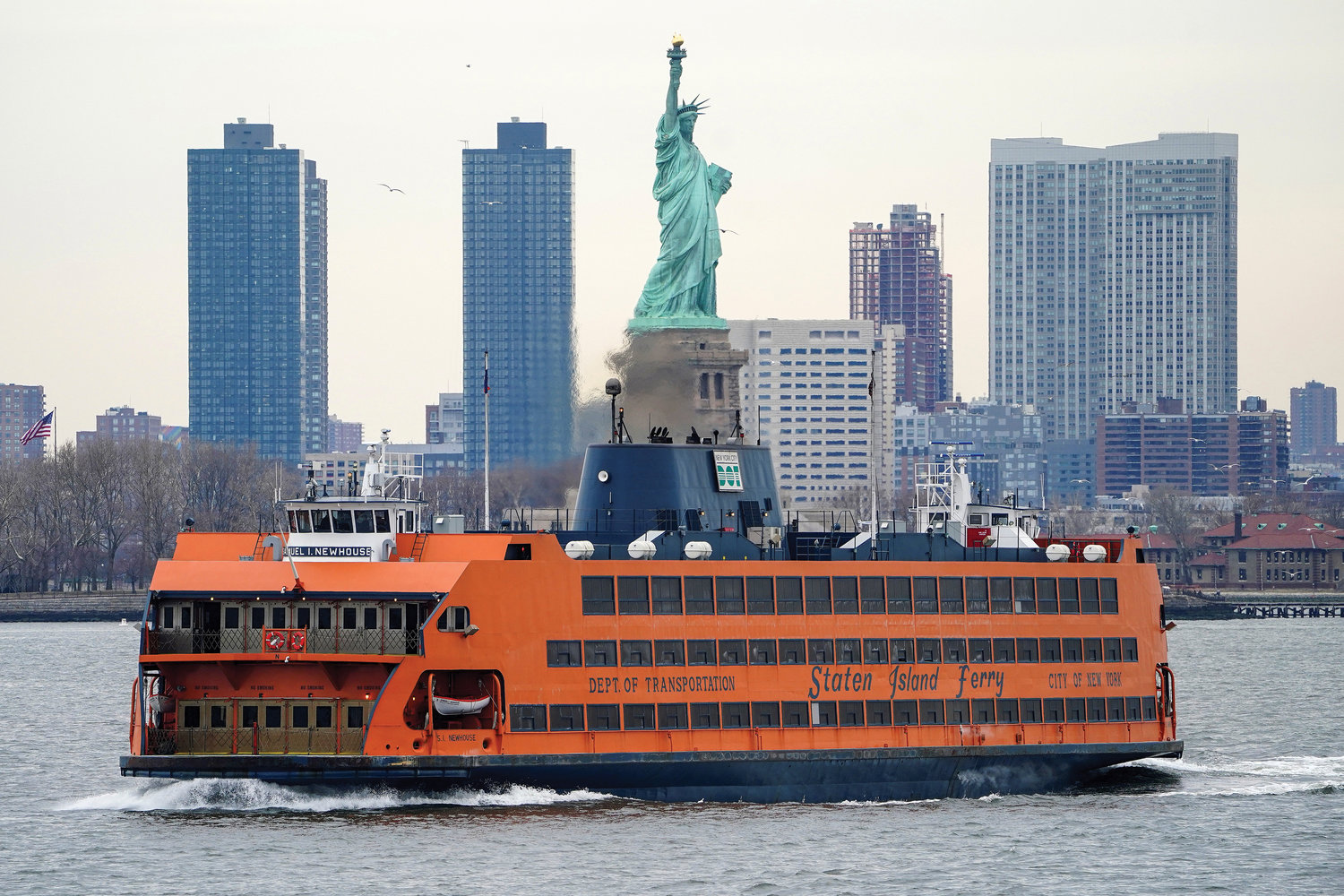 The Staten Island Ferry moves past the Statue of Liberty in New York City. Mayor Bill de Blasio announced March 25 that one of three new Staten Island Ferry boats will be named for Catholic Worker Movement co-founder Dorothy Day, whose sainthood cause is being considered by the Vatican.