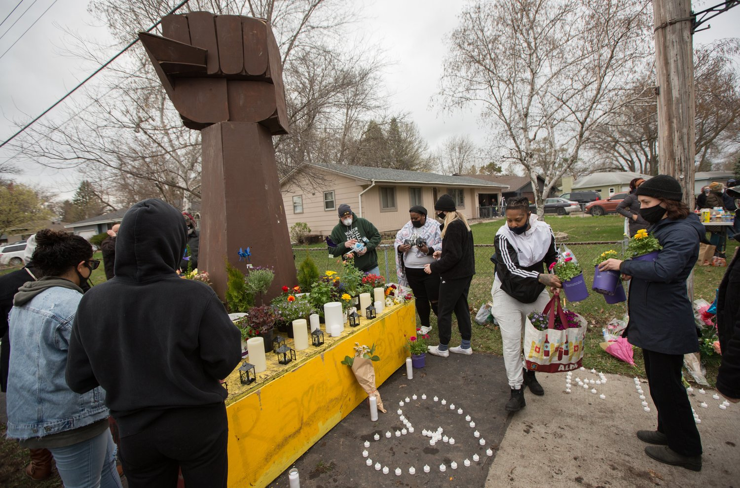 Family members, friends and other members of the community gather at a memorial put up at the site in Brooklyn Center, Minn., April 12, where Daunte Wright was shot by a Brooklyn Center police officer and died April 11 during a traffic stop.